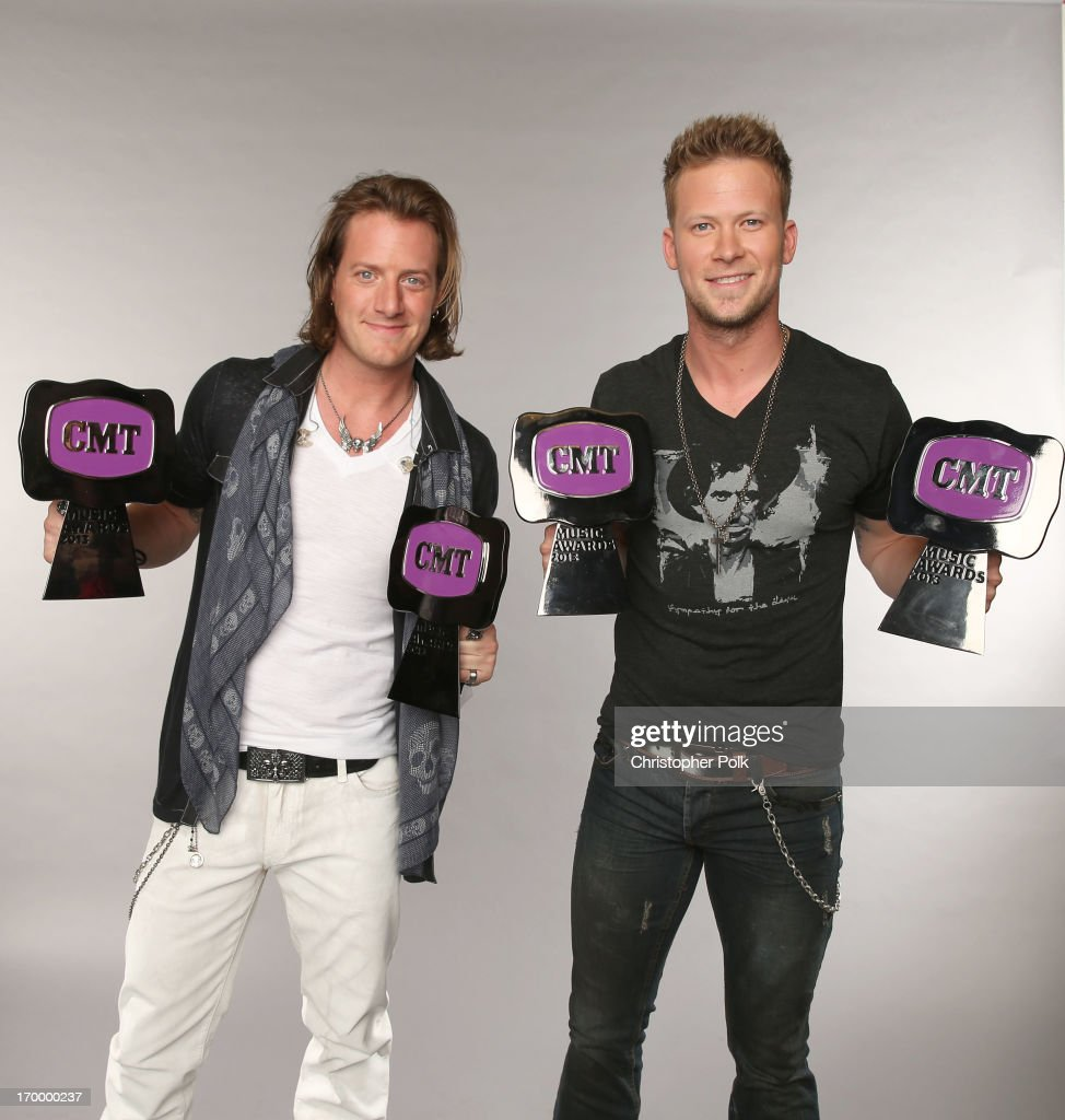Tyler Hubbard and Brian Kelley of Florida Georgia Line pose at the Wonderwall portrait studio during the 2013 CMT Music Awards at Bridgestone Arena on June 5, 2013 in Nashville, Tennessee.