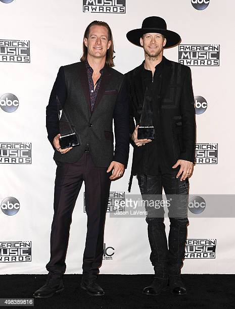 Tyler Hubbard and Brian Kelley of Florida Georgia Line pose in the press room at the 2015 American Music Awards at Microsoft Theater on November 22...
