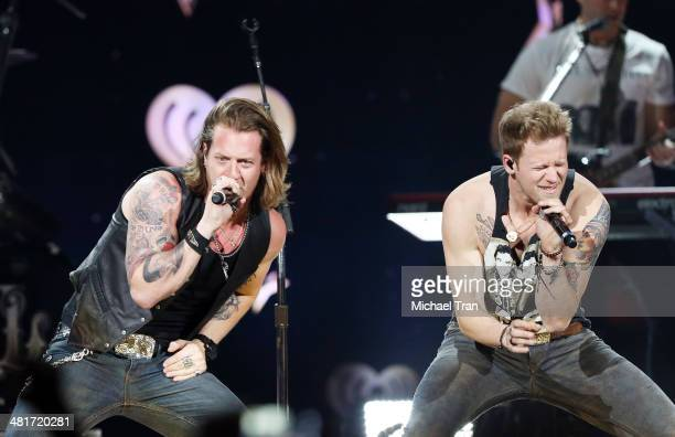 Tyler Hubbard and Brian Kelly of Florida Georgia Line perform onstage during the iHeartRadio Country Festival at the Frank Erwin Center on March 29...
