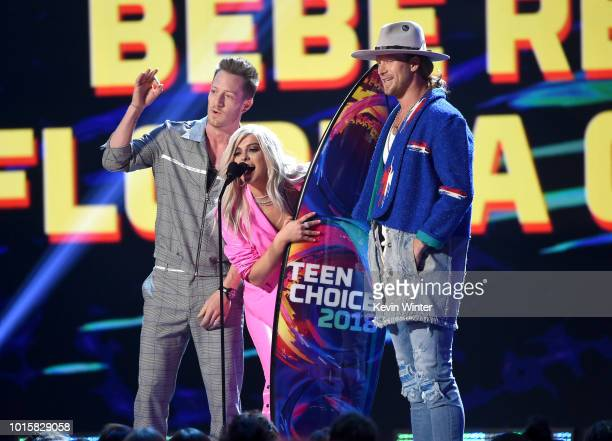 Tyler Hubbard Bebe Rexha and Brian Kelley of Florida Georgia Line accept the Choice Country Song onstage during FOX's Teen Choice Awards at The Forum...