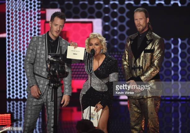 Tyler Hubbard Bebe Rexha and Brian Kelley speak onstage during the 2018 American Music Awards at Microsoft Theater on October 9 2018 in Los Angeles...
