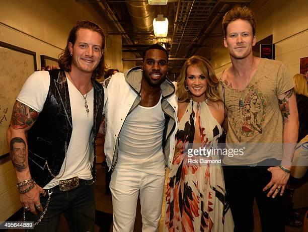 Tyler Hubbard Jason Derulo Carrie Underwood and Brian Kelly attend the 2014 CMT Music Awards at Bridgestone Arena on June 4 2014 in Nashville...