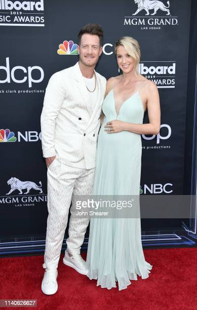 Tyler Hubbard of Florida Georgia Line and Hayley Stommel attend the 2019 Billboard Music Awards at MGM Grand Garden Arena on May 1 2019 in Las Vegas...