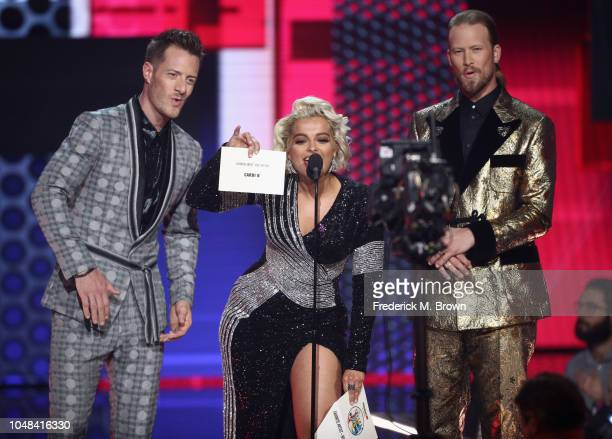 Tyler Hubbard of Florida Georgia Line Bebe Rexha and Brian Kelley of Florida Georgia Line speak onstage during the 2018 American Music Awards at...
