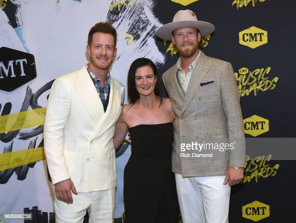 Tyler Hubbard of Florida Georgia Line Senior VP of Music Strategy at CMT Leslie Fram and Brian Kelley of Florida Georgia Line attend the 2018 CMT...