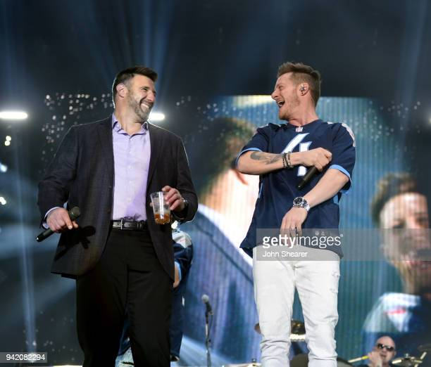 Tyler Hubbard of multiplatinum superstar duo Florida Georgia Line performs onstage to with Titans head coach Mike Vrabel during The NFL's Tennessee...