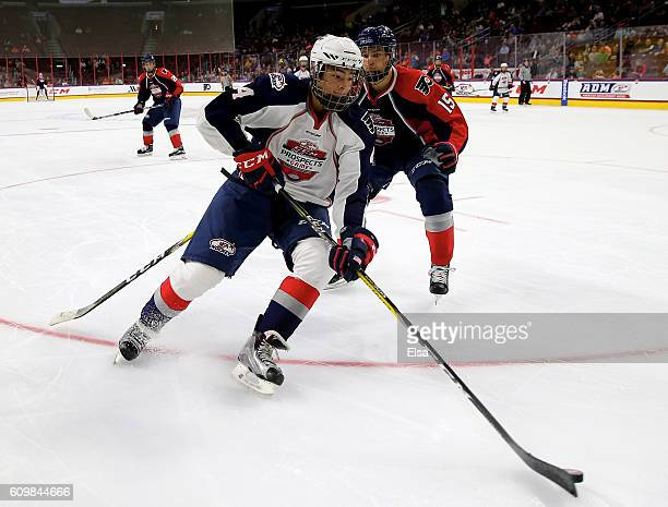 Tyler Inamoto of Team LeClair takes the puck as Josh Norris of Team Howe defends during the CCM/USA Hockey AllAmerican Prospects Game on September 22...