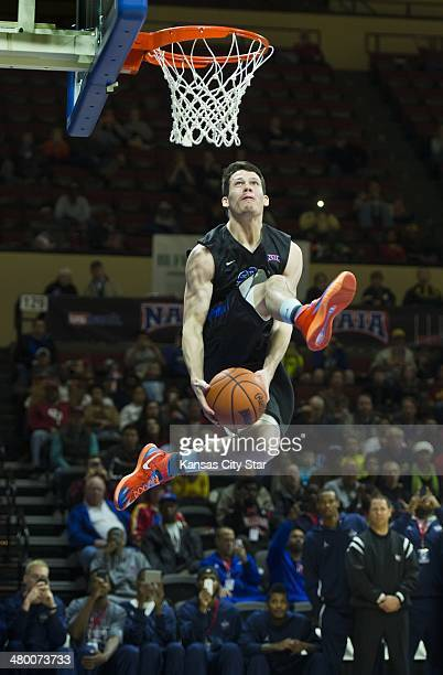 Tyler Inman of Southestern Christian passes the basketball between his legs during the NAIA slam dunk contest on Saturday March 22 during the NAIA...