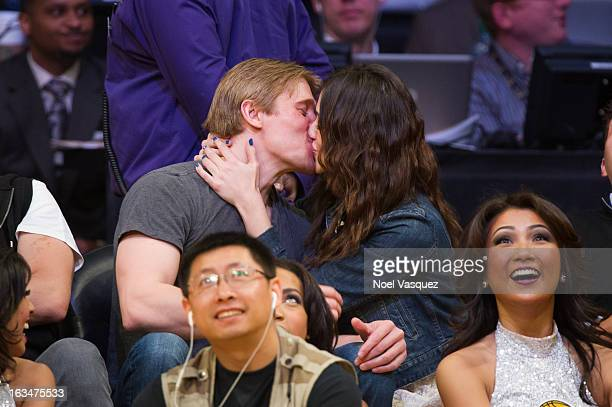 Tyler Jacob Moore and Emmy Rossum kiss at a basketball game between the Chicago Bulls and Los Angeles Lakers at Staples Center on March 10 2013 in...