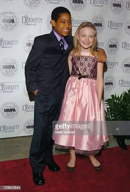 Tyler James Williams and Dakota Fanning during The 13th Annual Diversity Awards Red Carpet Arrivals at The Beverly Hills Hotel in Beverly Hills...