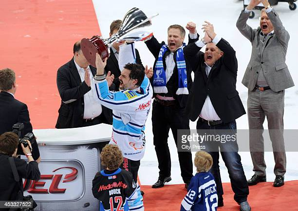 Tyler John Bouck receives the Trophy from Gernot Tripcke after game seven of the DEL playoff final on April 29 2014 in Cologne Germany