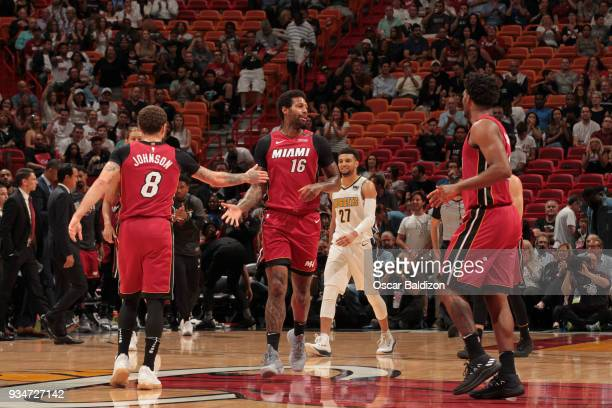 Tyler Johnson and James Johnson of the Miami Heat react during game against the Denver Nuggets on March 19 2018 at American Airlines Arena in Miami...