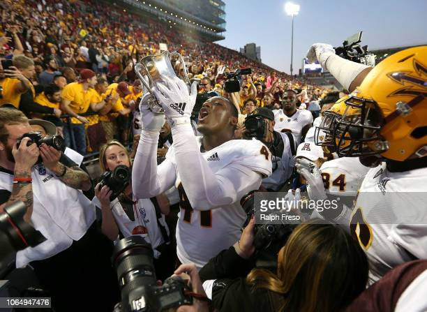 Tyler Johnson of the Arizona State Sun Devils celebrates with the Territorial Cup following a 4140 victory against the Arizona Wildcats during the...