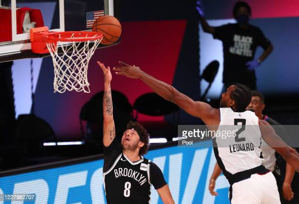 Tyler Johnson of the Brooklyn Nets shoots against Kawhi Leonard of the LA Clippers in the second half of a NBA basketball game at AdventHealth Arena...