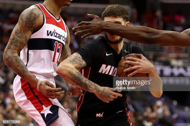 Tyler Johnson of the Miami Heat dribbles past Kelly Oubre Jr #12 of the Washington Wizards during the first half at Capital One Arena on March 6 2018...