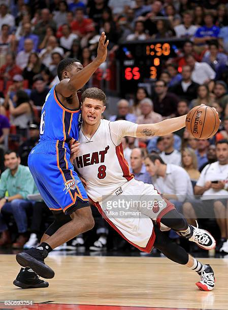 Tyler Johnson of the Miami Heat drives on Semaj Christon of the Oklahoma City Thunder during a game at American Airlines Arena on December 27 2016 in...