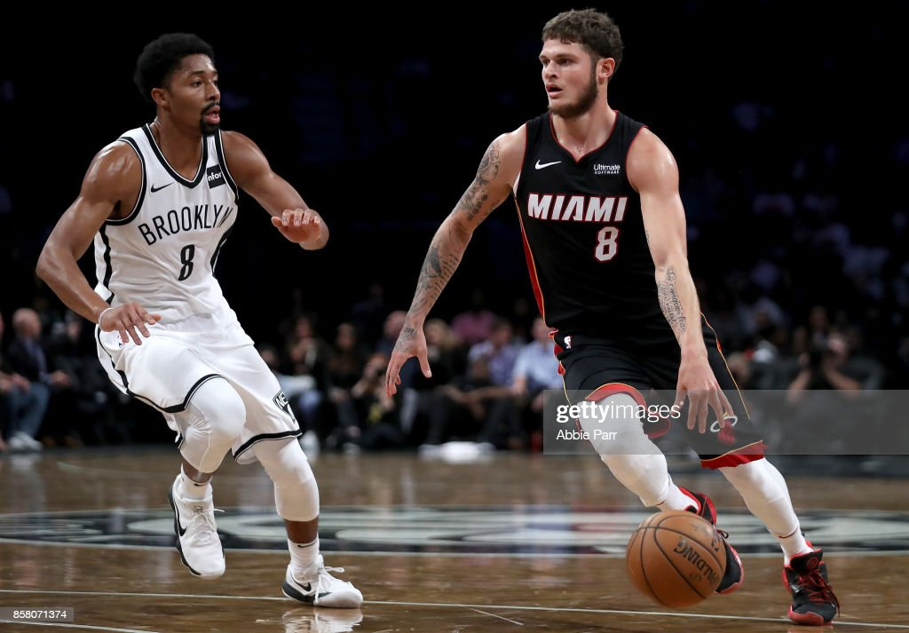 Tyler Johnson #8 of the Miami Heat drives to the basket against Spencer Dinwiddie #8 of the Brooklyn Nets in the first half during their Pre Season game at Barclays Center on October 5, 2017 in the Brooklyn Borough of New York City.