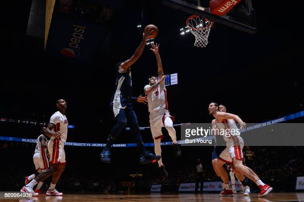Tyler Johnson of the Miami Heat goes to block the shot against the Denver Nuggets on November 3 2017 at the Pepsi Center in Denver Colorado NOTE TO...