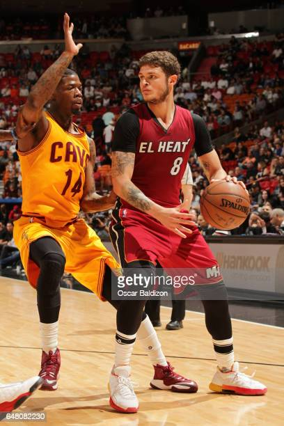 Tyler Johnson of the Miami Heat handles the ball against DeAndre Liggins of the Cleveland Cavaliers during the game on March 4 2017 at American...