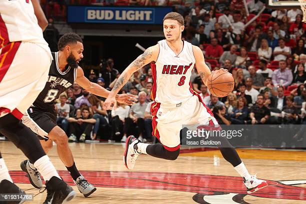Tyler Johnson of the Miami Heat handles the ball against Patty Mills of the San Antonio Spurs during a game on October 30 2016 at American Airlines...