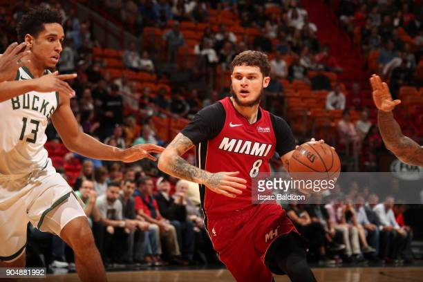 Tyler Johnson of the Miami Heat handles the ball against the Milwaukee Bucks on January 14 2018 at American Airlines Arena in Miami Florida NOTE TO...
