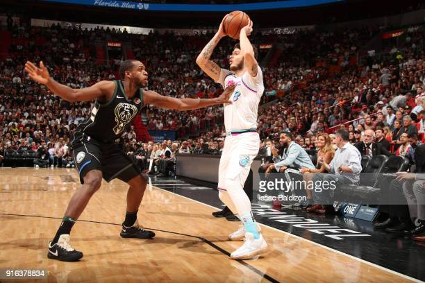 Tyler Johnson of the Miami Heat passes the ball during the game against Khris Middleton of the Milwaukee Bucks on February 9 2018 at American...