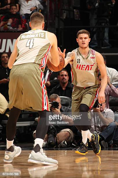 Tyler Johnson of the Miami Heat passes the ball to Josh McRoberts of the Miami Heat on November 15 2016 at American Airlines Arena in Miami Florida...