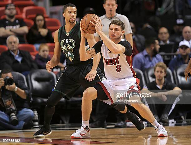 Tyler Johnson of the Miami Heat posts up Michael CarterWilliams of the Milwaukee Bucks during a game at American Airlines Arena on January 19 2016 in...