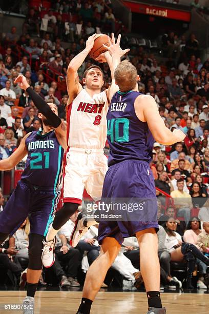 Tyler Johnson of the Miami Heat shoots the ball against Cody Zeller of the Charlotte Hornets during a game on October 28 2016 at American Airlines...