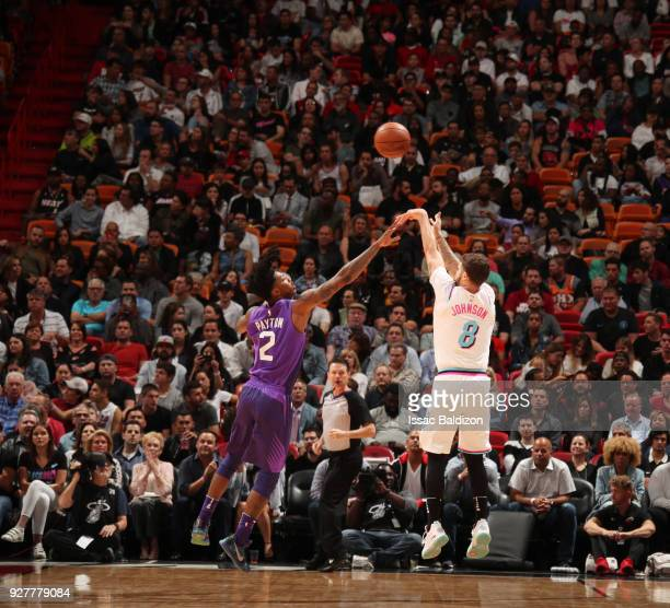 Tyler Johnson of the Miami Heat shoots the ball against Elfrid Payton of the Phoenix Suns on March 5 2018 at American Airlines Arena in Miami Florida...