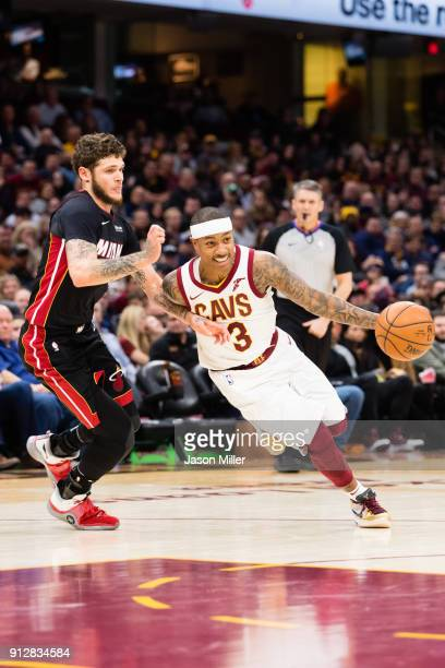 Tyler Johnson of the Miami Heat tries to stop Isaiah Thomas of the Cleveland Cavaliers during the second half at Quicken Loans Arena on January 31...