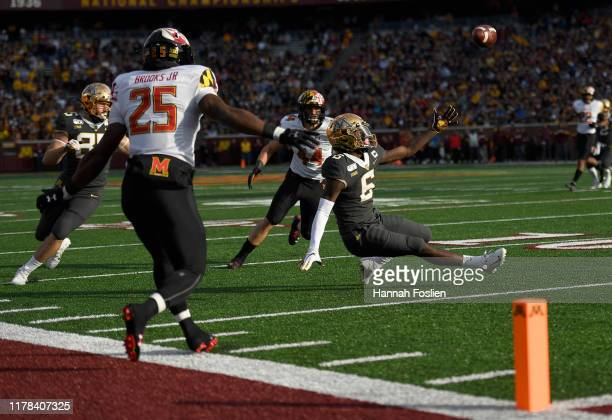 Tyler Johnson of the Minnesota Gophers is unable to make a reception against Antoine Brooks Jr. #25 and Chance Campbell of the Maryland Terrapins...