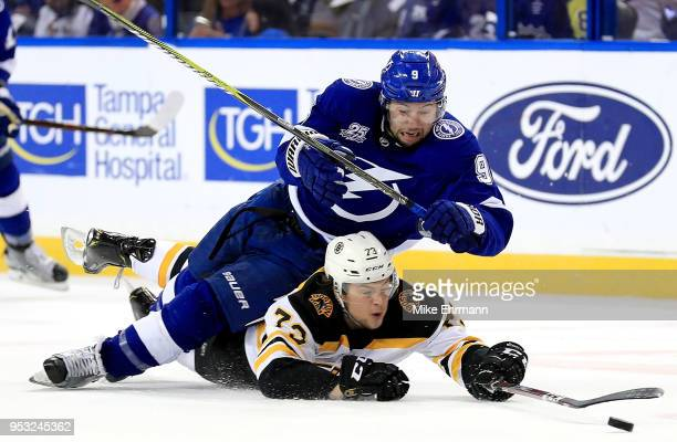 Tyler Johnson of the Tampa Bay Lightning and Charlie McAvoy of the Boston Bruins fight for the puck during Game Two of the Eastern Conference Second...