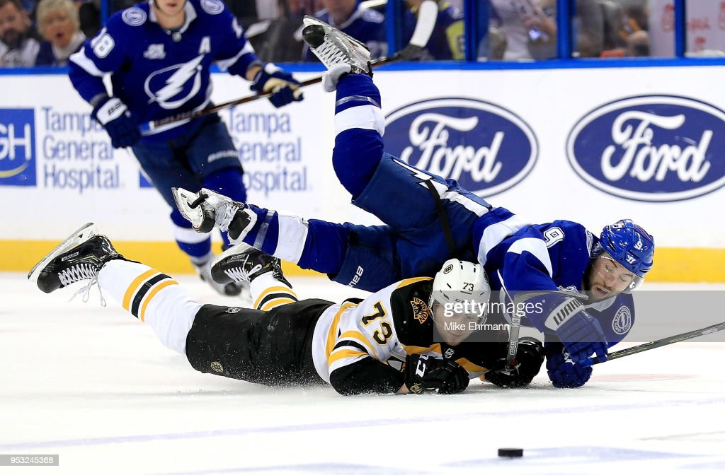 Tyler Johnson #9 of the Tampa Bay Lightning and Charlie McAvoy #73 of the Boston Bruins fight for the puck during Game Two of the Eastern Conference Second Round during the 2018 NHL Stanley Cup Playoffs at Amalie Arena on April 30, 2018 in Tampa, Florida.