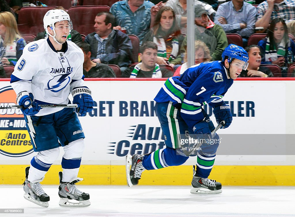 Tyler Johnson #9 of the Tampa Bay Lightning and Linden Vey #7 of the Vancouver Canucks skate up ice during their NHL game at Rogers Arena October 18, 2014 in Vancouver, British Columbia, Canada.
