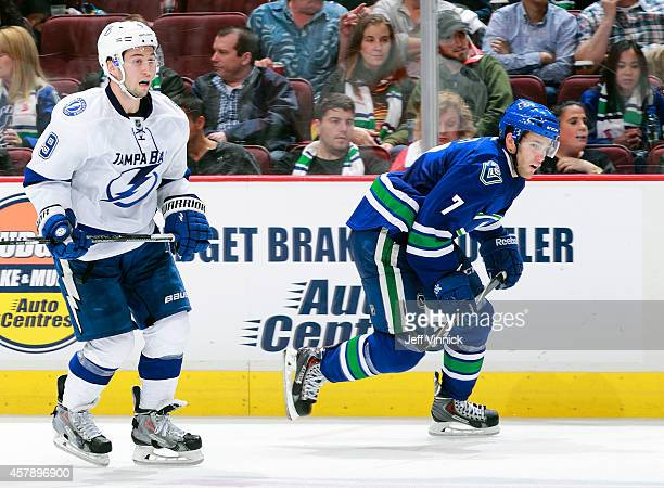 Tyler Johnson of the Tampa Bay Lightning and Linden Vey of the Vancouver Canucks skate up ice during their NHL game at Rogers Arena October 18 2014...