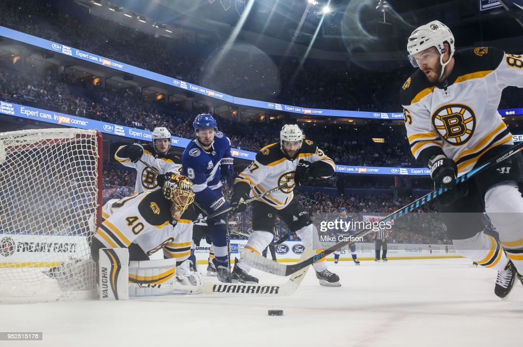 Tyler Johnson #9 of the Tampa Bay Lightning battles for the puck against goalie Tuukka Rask #40, Patrice Bergeron #37, and Kevan Miller #86 of the Boston Bruins during Game One of the Eastern Conference Second Round during the 2018 NHL Stanley Cup Playoffs at Amalie Arena on April 28, 2018 in Tampa, Florida.