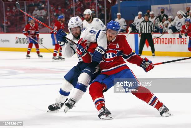 Tyler Johnson of the Tampa Bay Lightning battles with Brendan Gallagher of the Montreal Canadiens during Game Three of the 2021 NHL Stanley Cup Final...