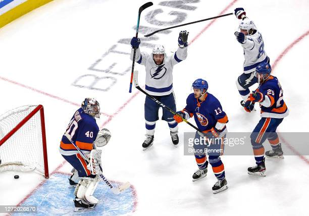 Tyler Johnson of the Tampa Bay Lightning celebrates after scoring a goal past Semyon Varlamov of the New York Islanders during the third period in...