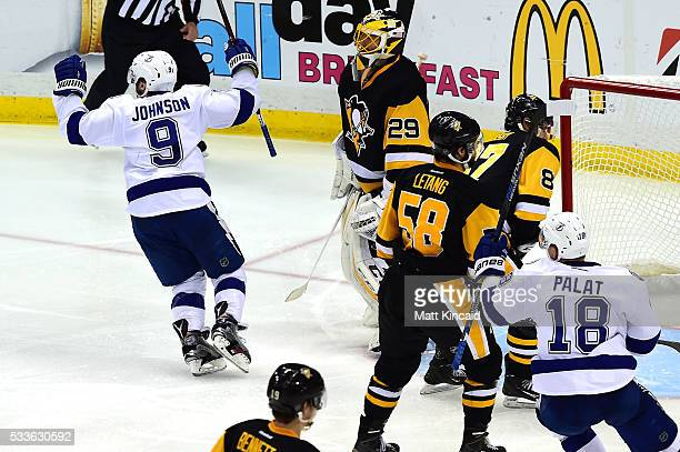 Tyler Johnson of the Tampa Bay Lightning celebrates after scoring the game winning goal in overtime against MarcAndre Fleury of the Pittsburgh...