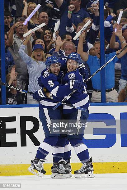 Tyler Johnson of the Tampa Bay Lightning celebrates his goal with Ondrej Palat of the Tampa Bay Lightning during the first period against the New...
