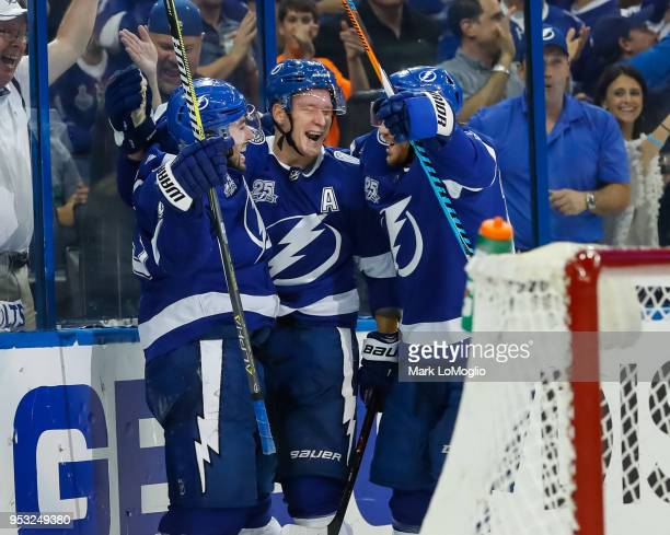 Tyler Johnson of the Tampa Bay Lightning celebrates his goal with teammate Ondrej Palat and Brayden Point against the Boston Bruins during Game Two...
