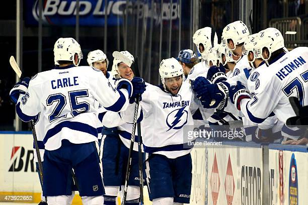 Tyler Johnson of the Tampa Bay Lightning celebrates his hat trick goal in the second period against Henrik Lundqvist of the New York Rangers during...