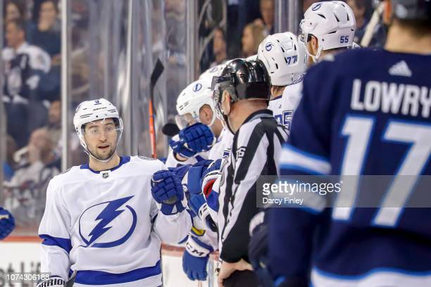 Tyler Johnson of the Tampa Bay Lightning celebrates his second period goal against the Winnipeg Jets with teammates at the bench at the Bell MTS...