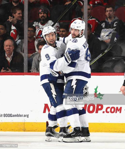 Tyler Johnson of the Tampa Bay Lightning celebrates his second period goal against the New Jersey Devils and is joined by Nikita Kucherov at the...