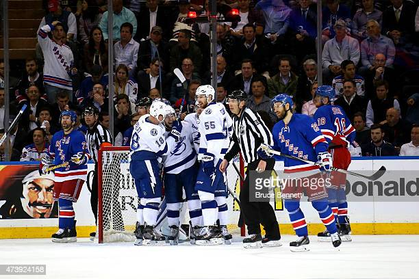 Tyler Johnson of the Tampa Bay Lightning celebrates with his teammates after scoring a hat trick goal in the second period against Henrik Lundqvist...