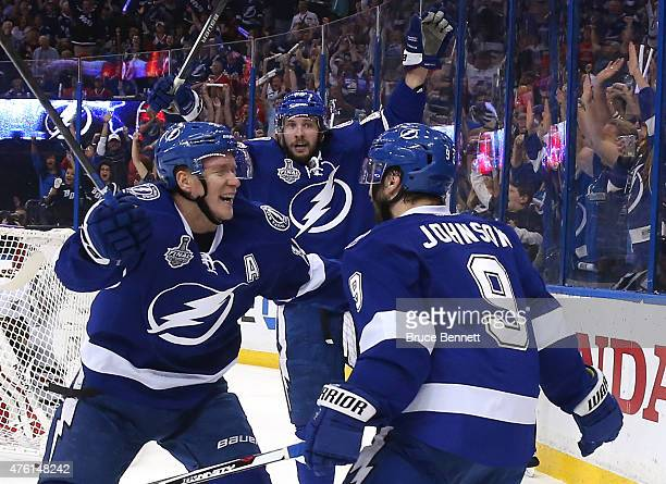 Tyler Johnson of the Tampa Bay Lightning celebrates with his teammates after scoring a goal in the second period against Corey Crawford of the...