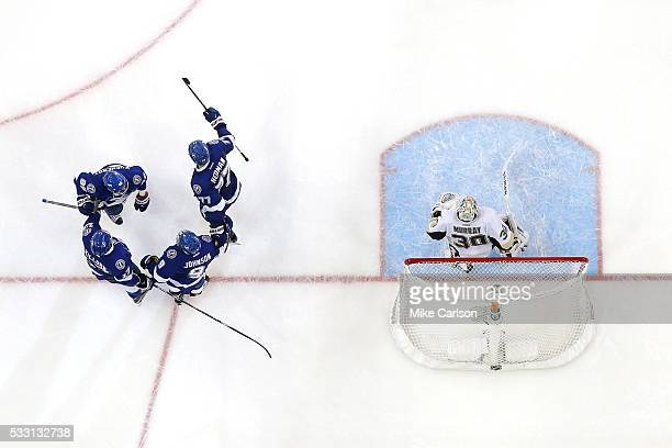 Tyler Johnson of the Tampa Bay Lightning celebrates with his teammates after scoring a goal against Matt Murray of the Pittsburgh Penguins during the...