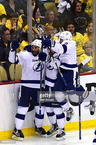 Tyler Johnson of the Tampa Bay Lightning celebrates with his teammates after scoring the game winning goal in overtime against MarcAndre Fleury of...