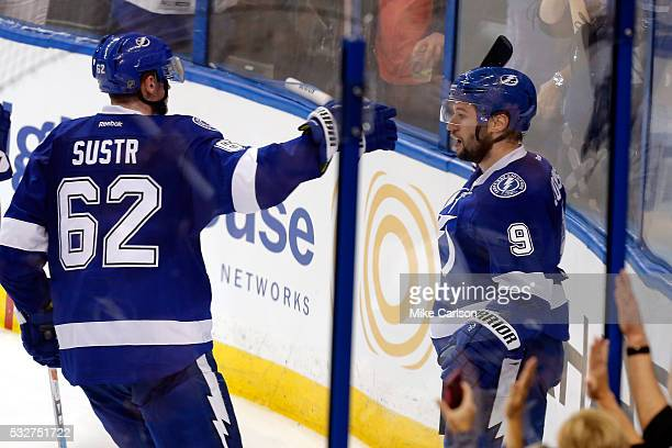 Tyler Johnson of the Tampa Bay Lightning celebrates with his teammate Andrej Sustr after scoring a goal against Matt Murray of the Pittsburgh...